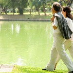 Couple walking by pond