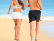 couple jogging on beach